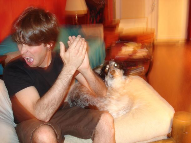 Give yourself a drunken round of applause, moron!  Me, drunk in LA, in 2007, with a dog named Peck.  Photo courtesy of Angela -  click through for her Flickr photostream.